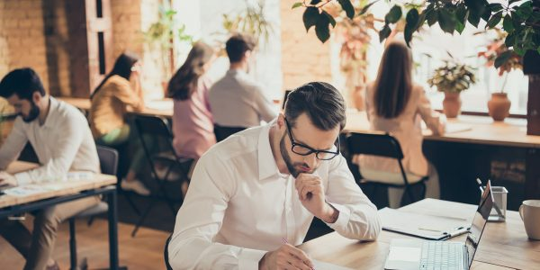Nice confident professional focused guy people financier agent broker, insurance consulting document researching at modern industrial loft brick open space style interior workplace workstation